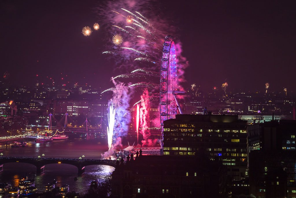 Spectacular Pink and Purple fireworks explode from the London Eye on New Years Eve 2016
